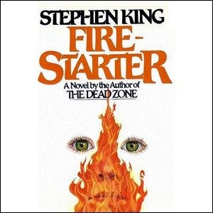 Cover of the Stephen King book Firestarter, featuring flames over the outline of a face.