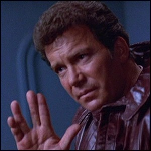 William Shatner performing the Vulcan salute, assisted by fishing line.