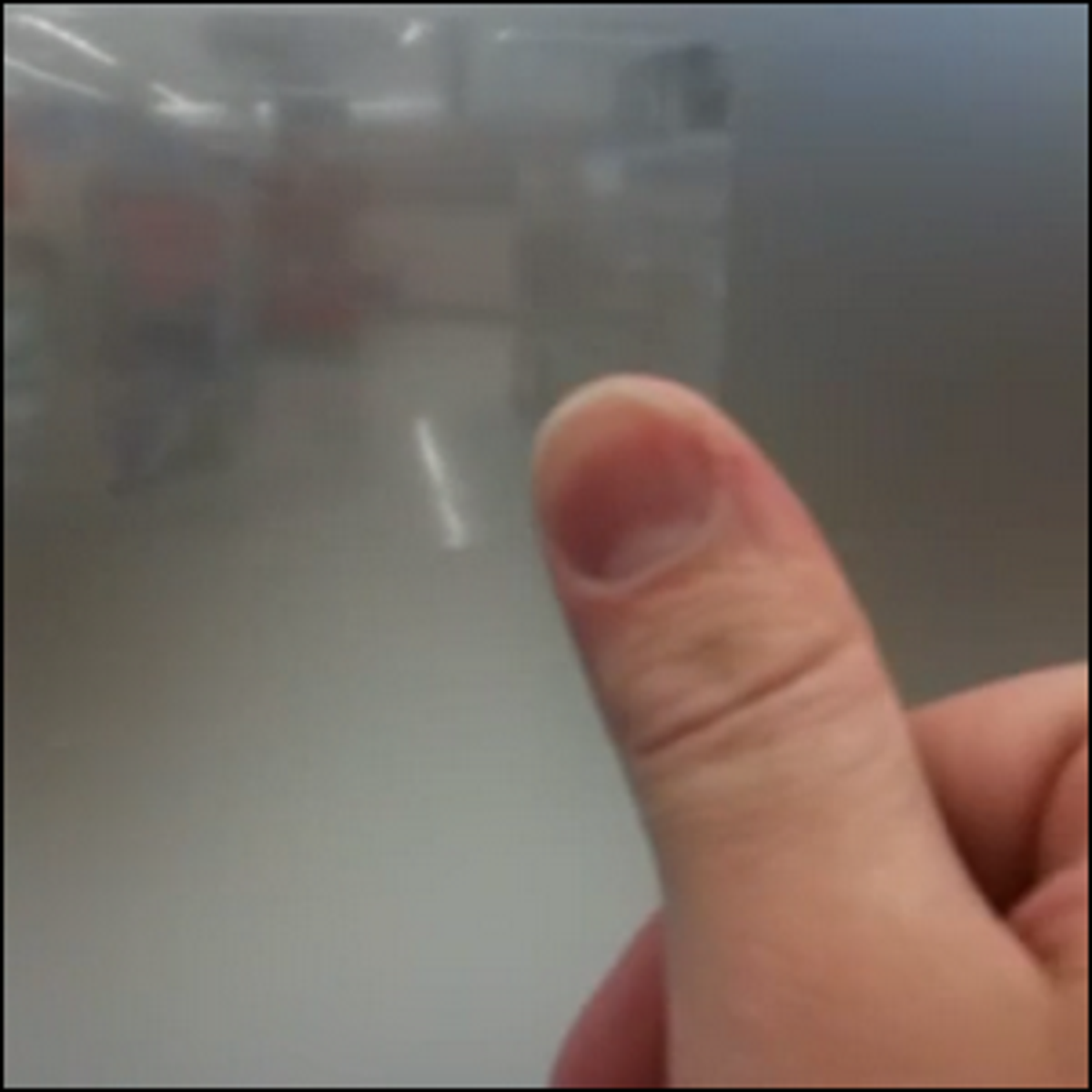 An example of using cellophane tape to peek through frosted glass.