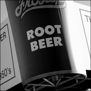 A sign outside a diner advertising root beer.