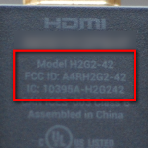 A close-up view of the first-generation Chromecast's model number.