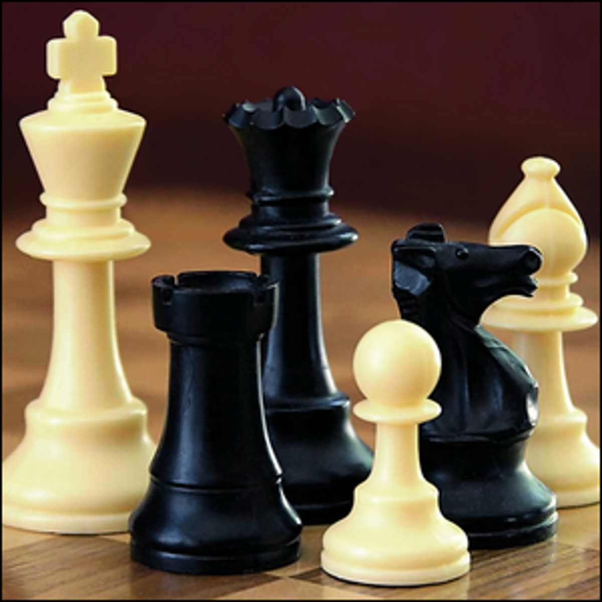 Close up view of chess pieces on a chess board.