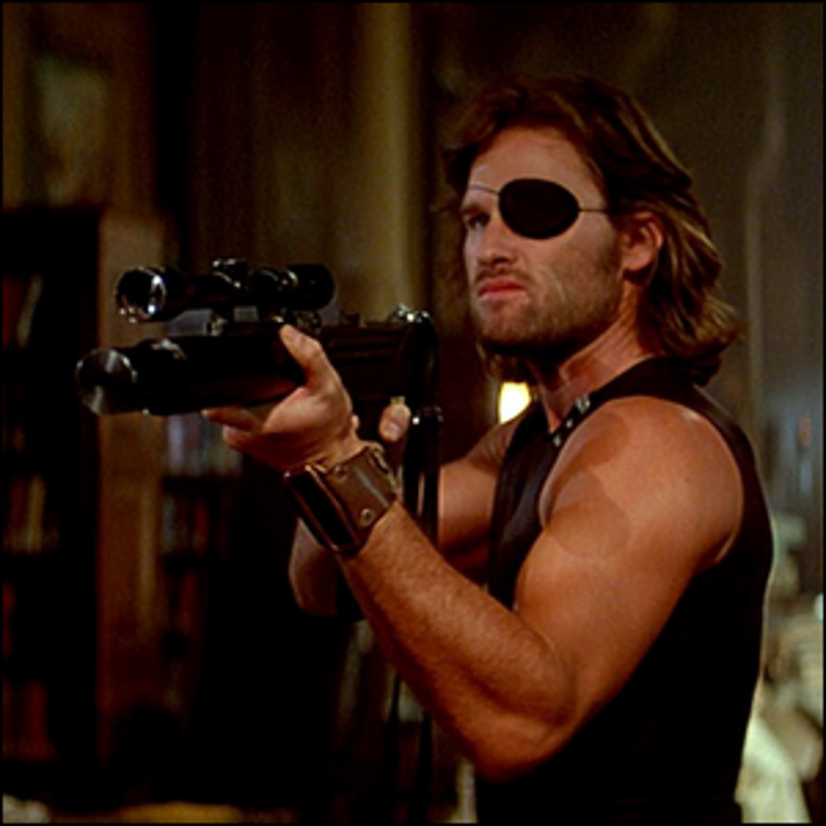 Kurt Russell holding a gun and wearing an eye patch as Snake Plissken.