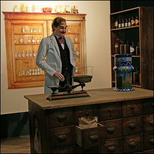 A painting of the inventor of Pepsi, Caleb Bradham, in his pharmacy.