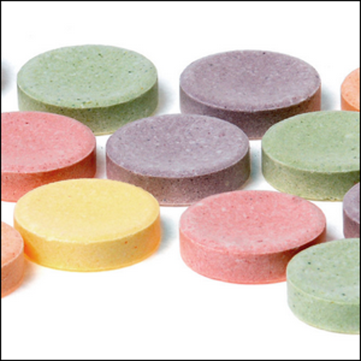 A group of giant-sized Smarties candy tablets.