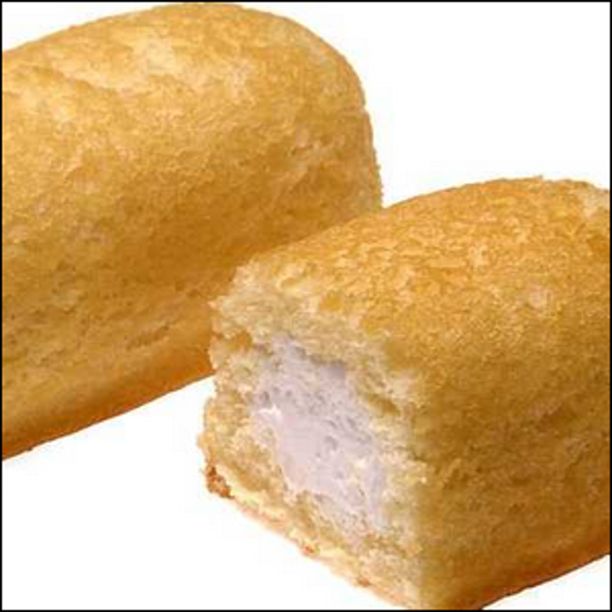 A promotional photo of a Twinkie treat cut in half.