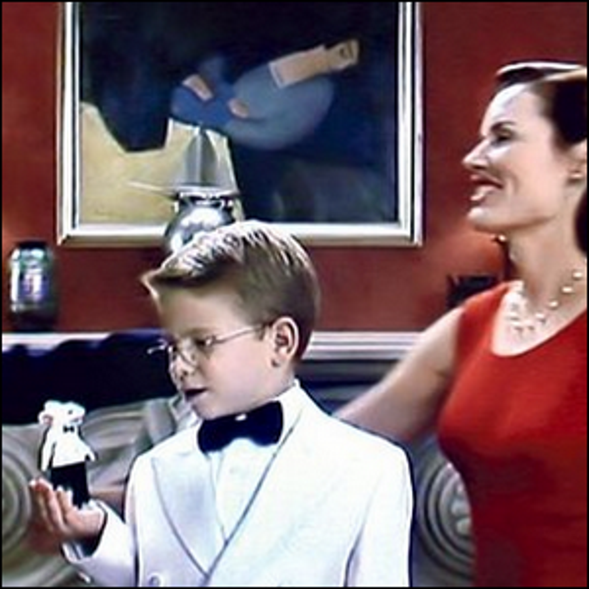A scene from Stuart Little with the painting visible in the background.