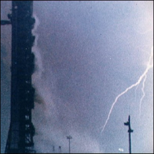 Lightning strikes the ground near the launch pad.