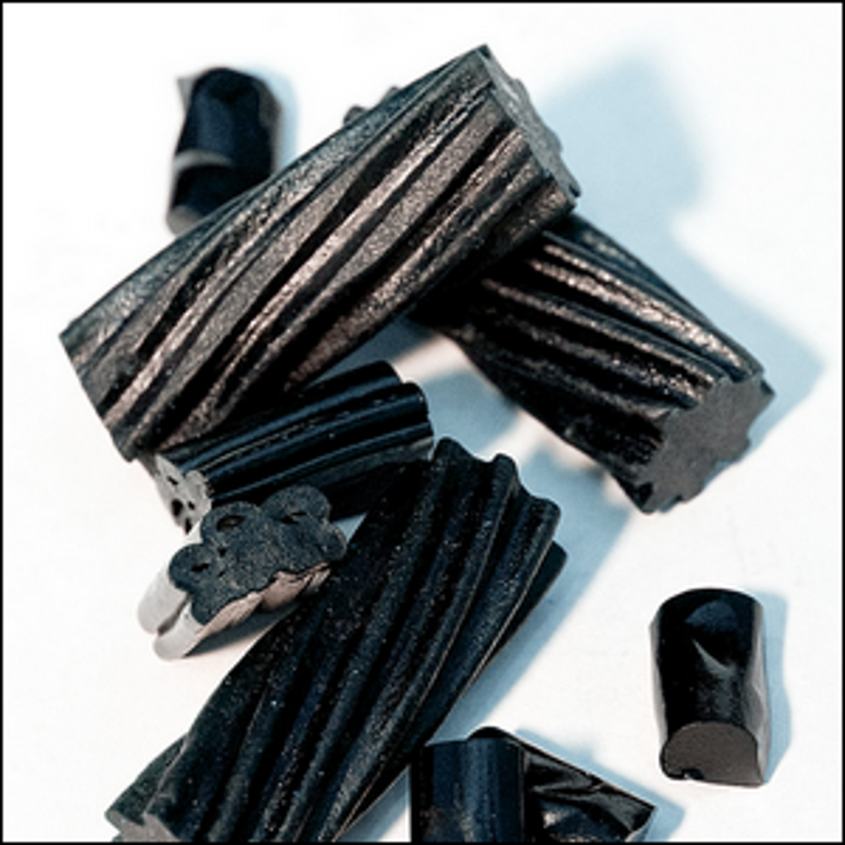 A close up view of a pile of licorice candy.