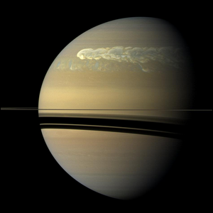 Photo of a huge storm churning through the atmosphere in Saturn's northern hemisphere.