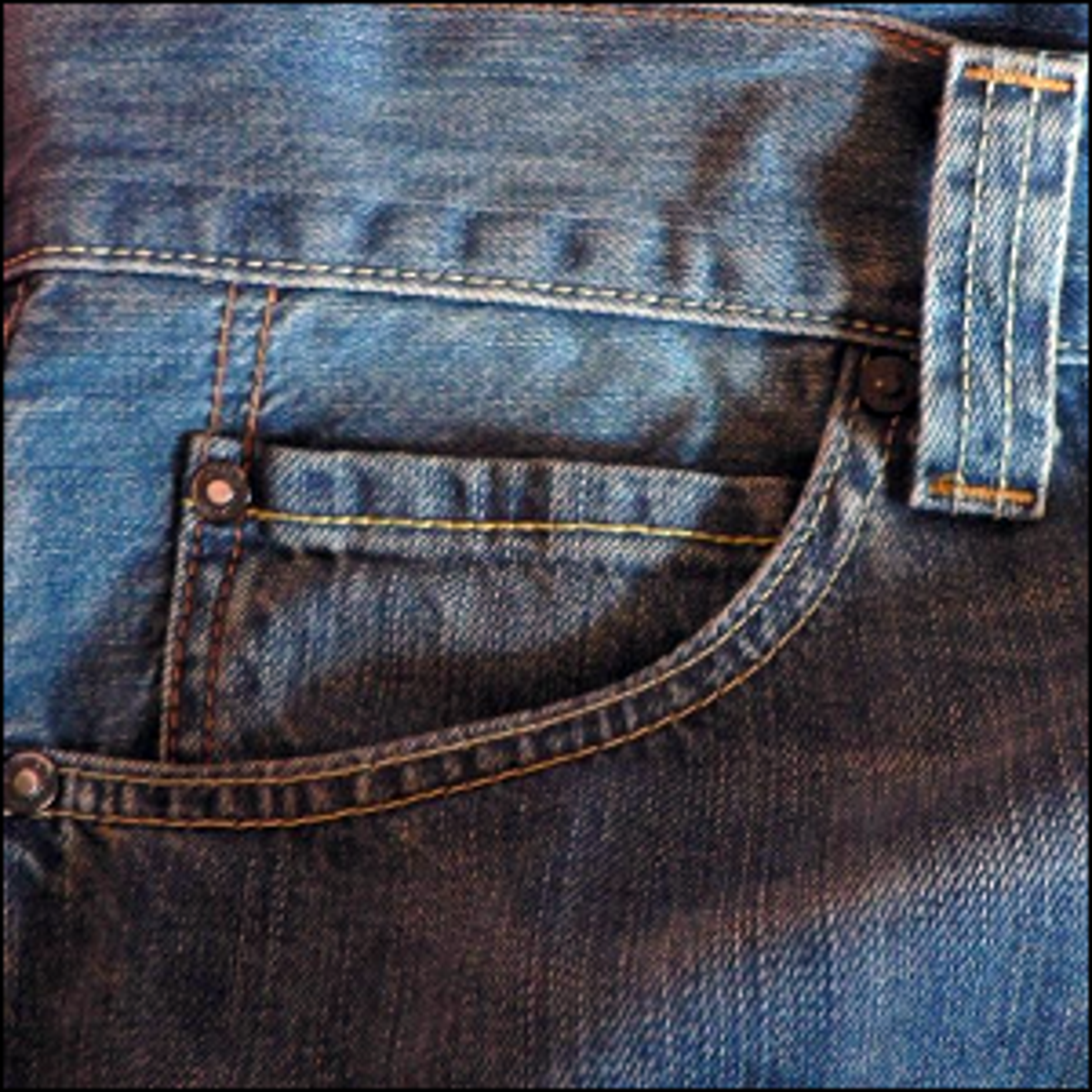 A pair of Levi's 506 jeans with a watch pocket sewn into the front pocket.