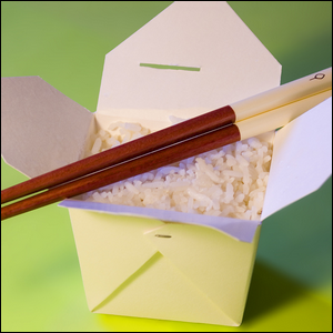 A Chinese takeout container filled with white rice.