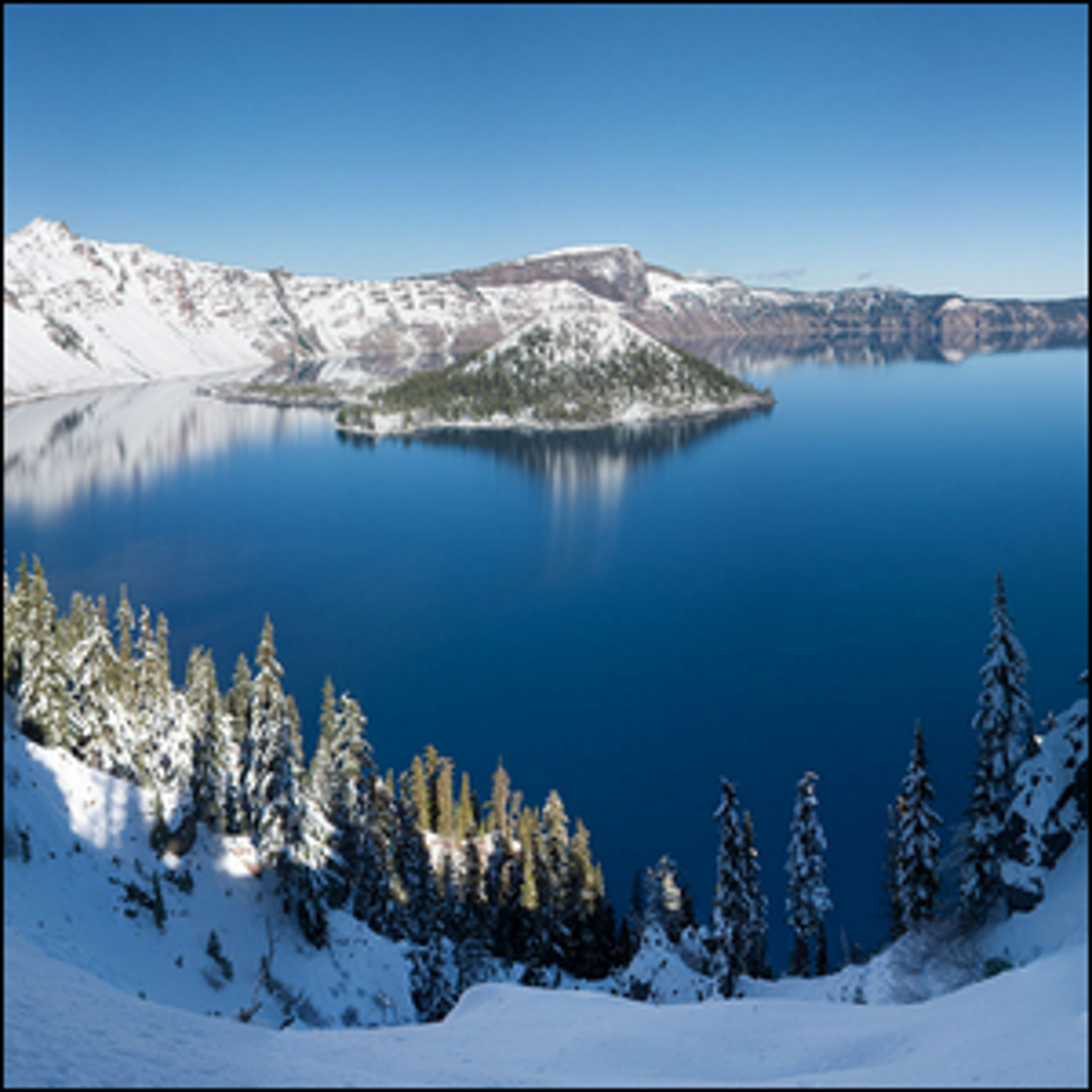 A panoramic winter view of Crater Lake in Crater Lake National Park, Oregon.