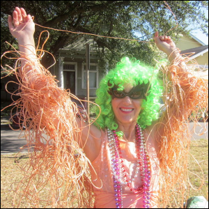 A woman with her arms covered in Silly String.