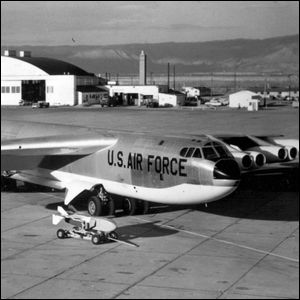 A Boeing B-52D next to a GAM-72 Quail decoy missile and trailer.