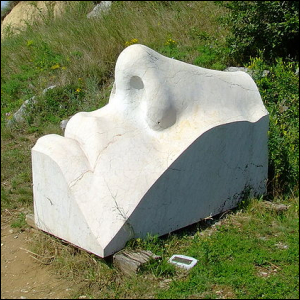 A sculpture of a human nose and partial face.