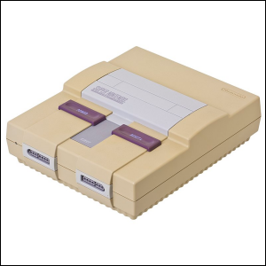 An old Super Nintendo Entertainment System with a yellowish-brown tinged outer case.