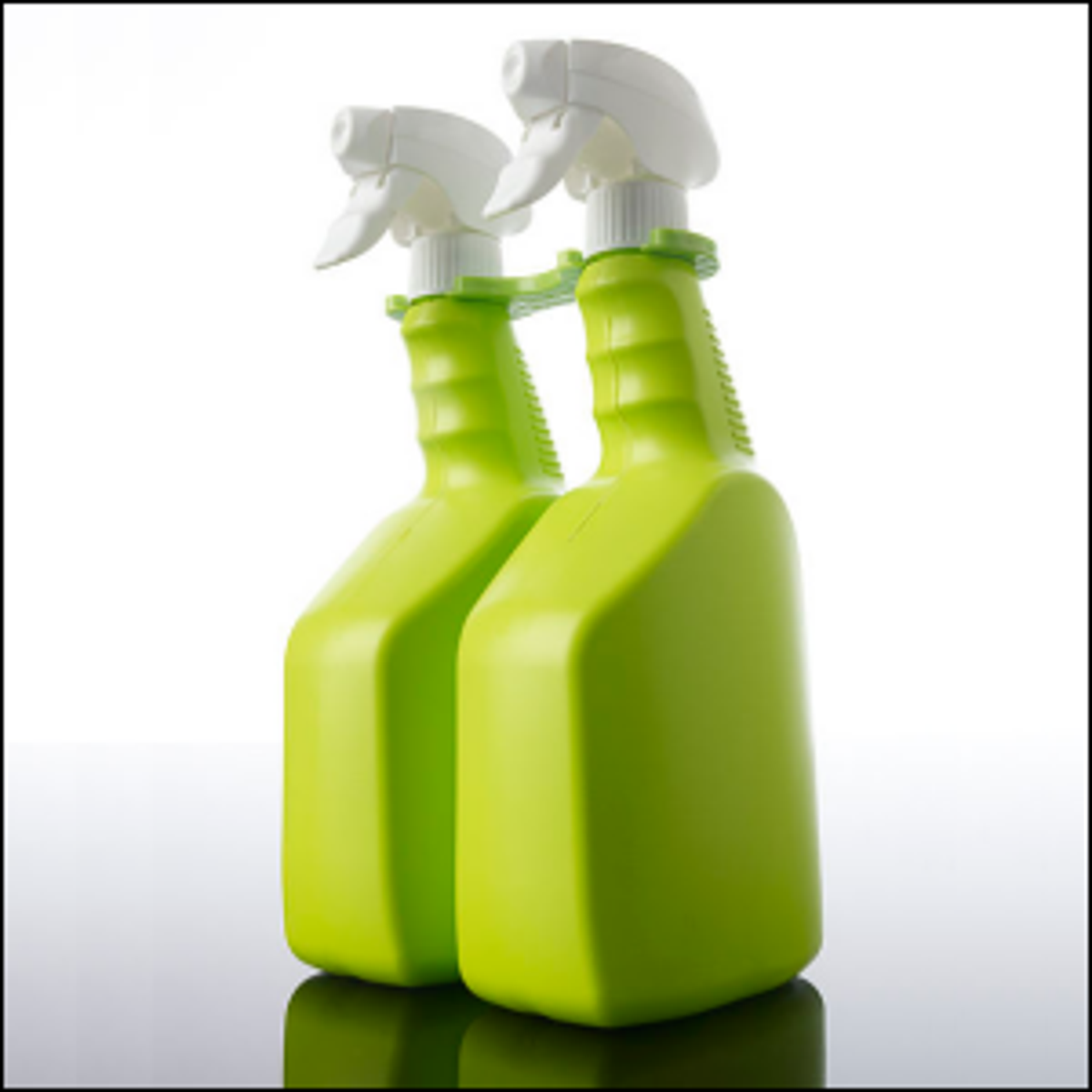 A pair of lime green spray bottles.