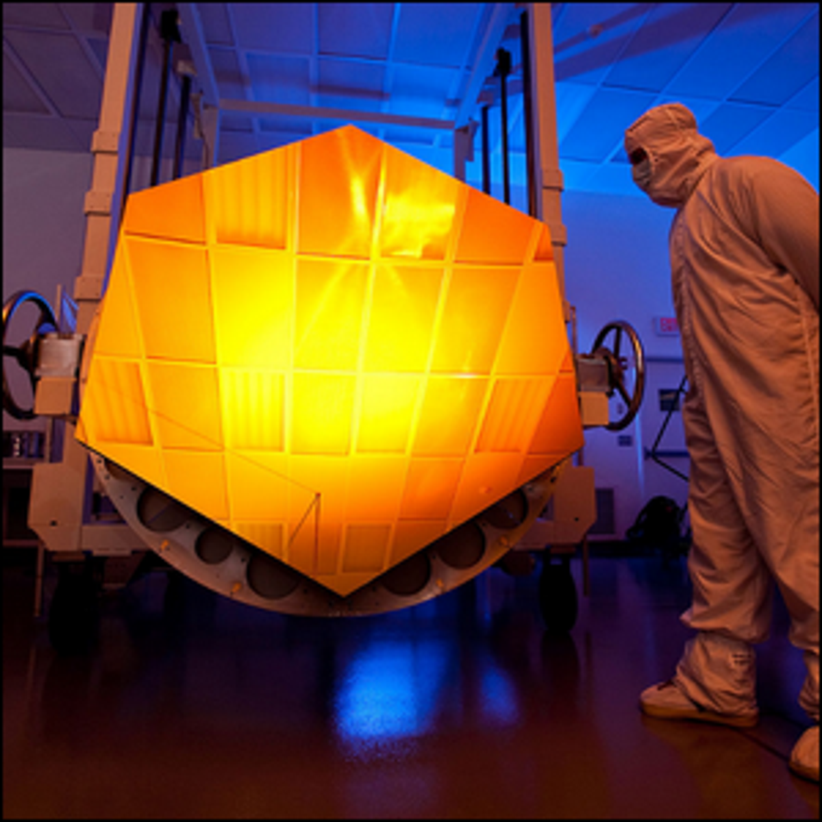 The James Webb Space Telescope's Engineering Design Unit (EDU) primary mirror segment, coated with gold.