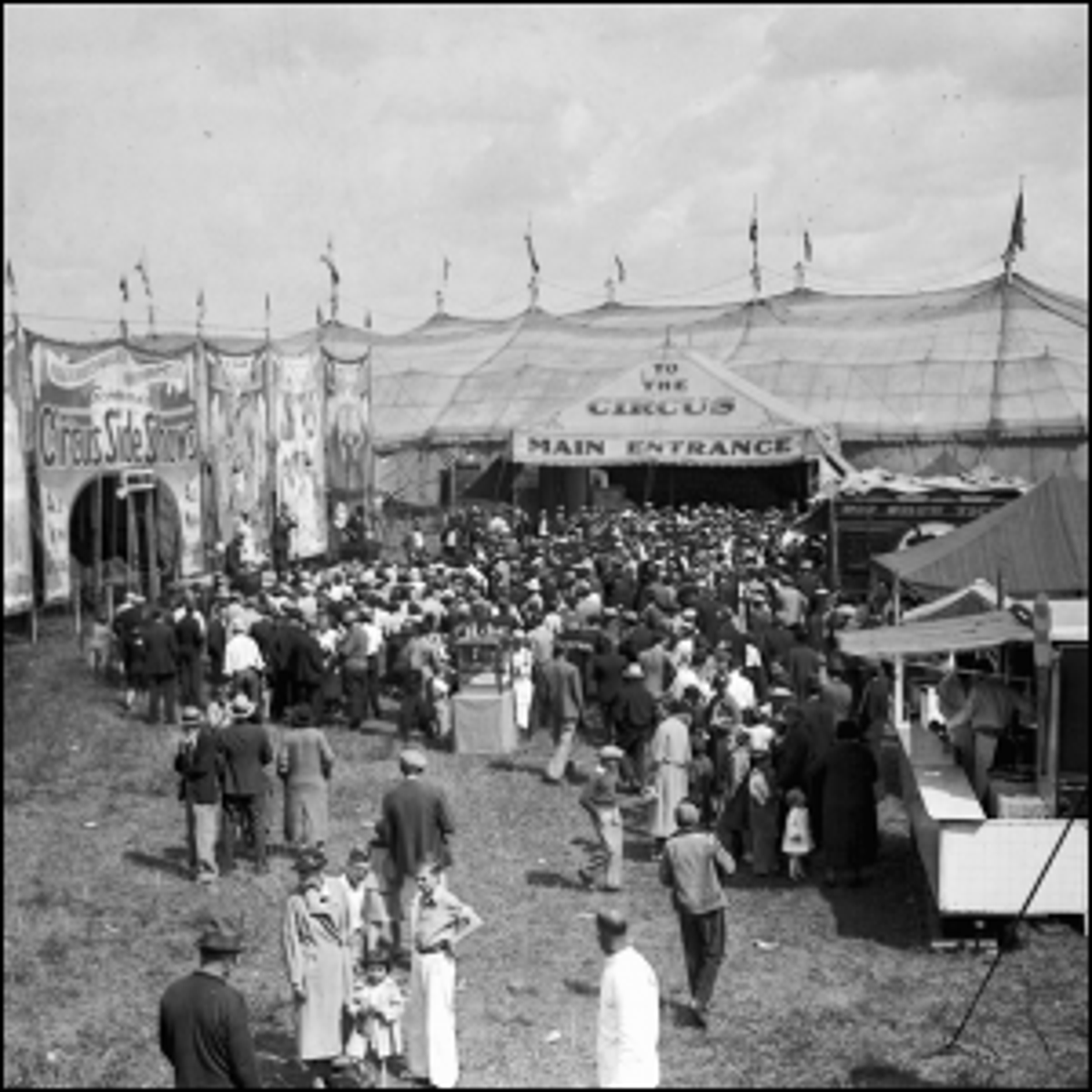 Photograph of a crowd heading towards the marquee tent of the Hagenbeck-Wallace Circus in 1935.