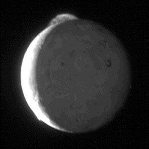 Photo of a giant plume from Io's Tvashtar volcano taken by the New Horizons probe in 2007.