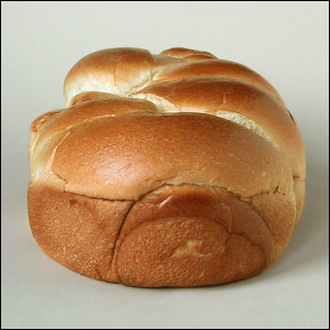 A brioche with a golden-brown crust as a result of the Maillard reaction.