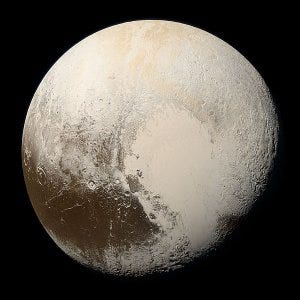 A photo of Pluto in true color, taken by NASA's New Horizons probe in 2015.