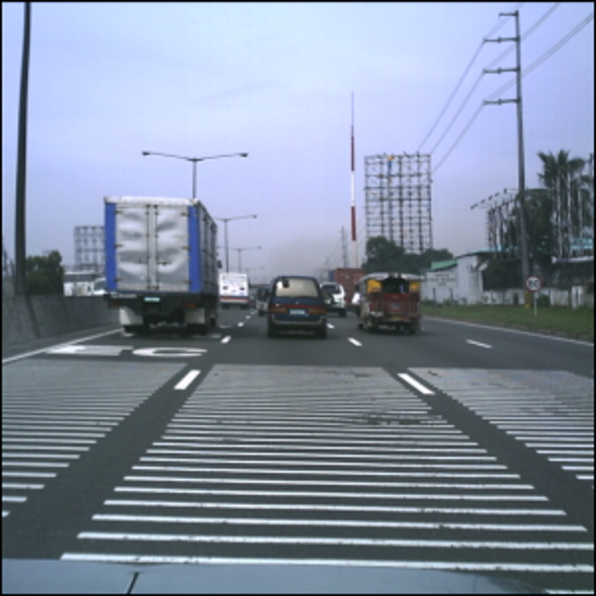 Rumble strips located along the North Luzon Expressway near Balintawak Toll Barrier.