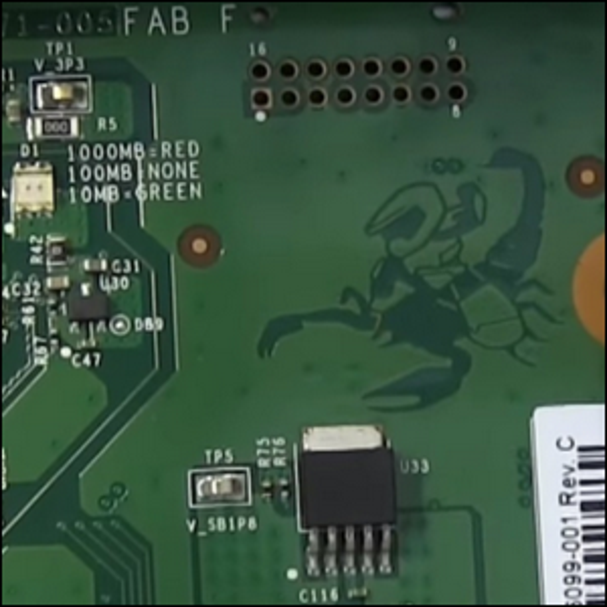 An image of Master Chief riding a scorpion etched on the motherboard of an Xbox One X.