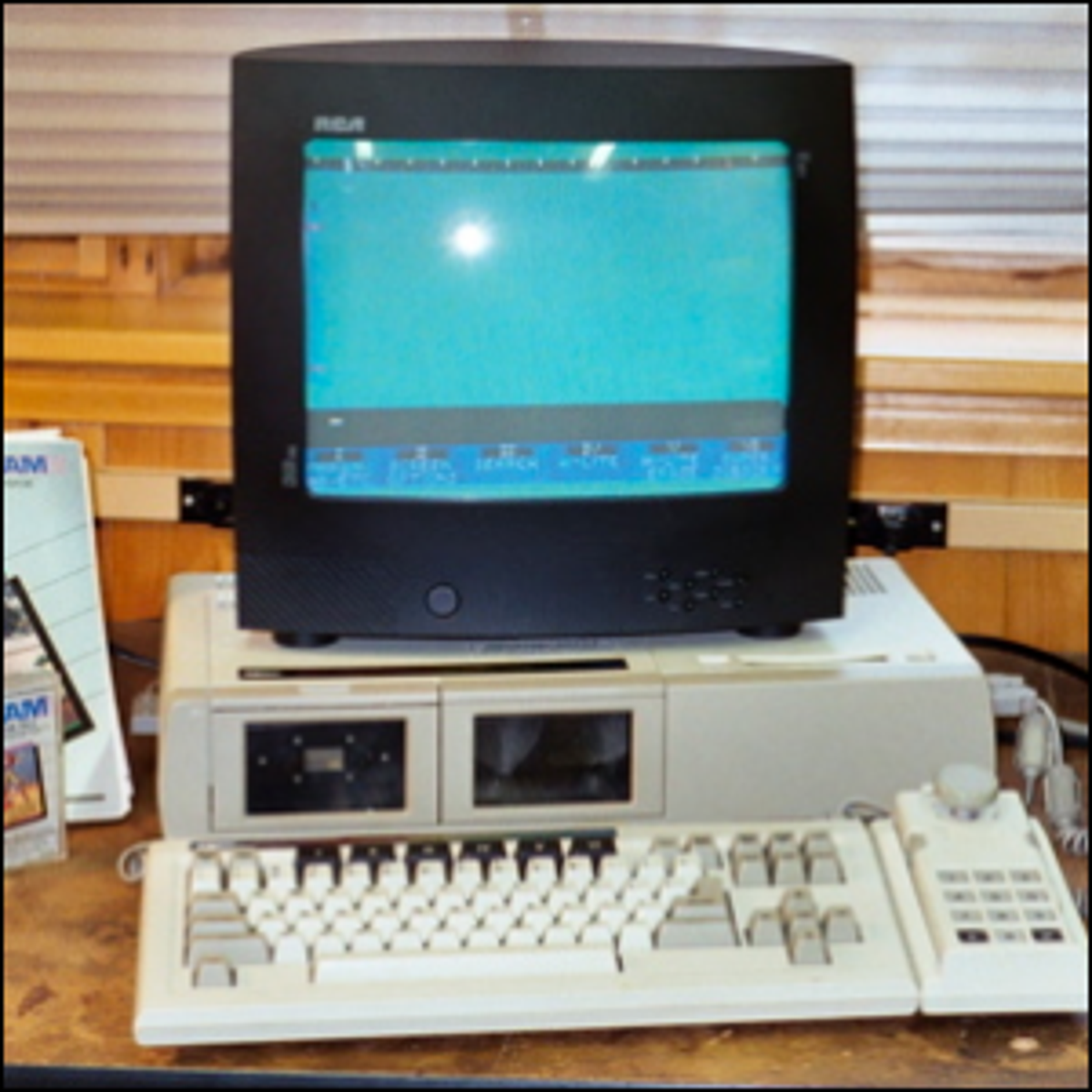 A Coleco Adam with a monitor, keyboard, printer, and software.