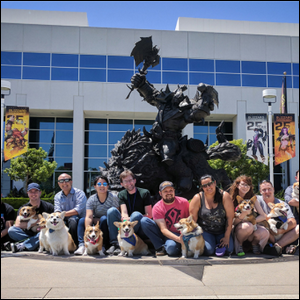 Blizzard employees with their pets in front of their workplace.