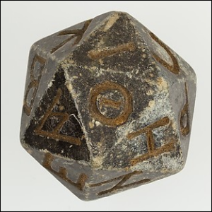 A twenty-sided die with faces inscribed with Greek letters.