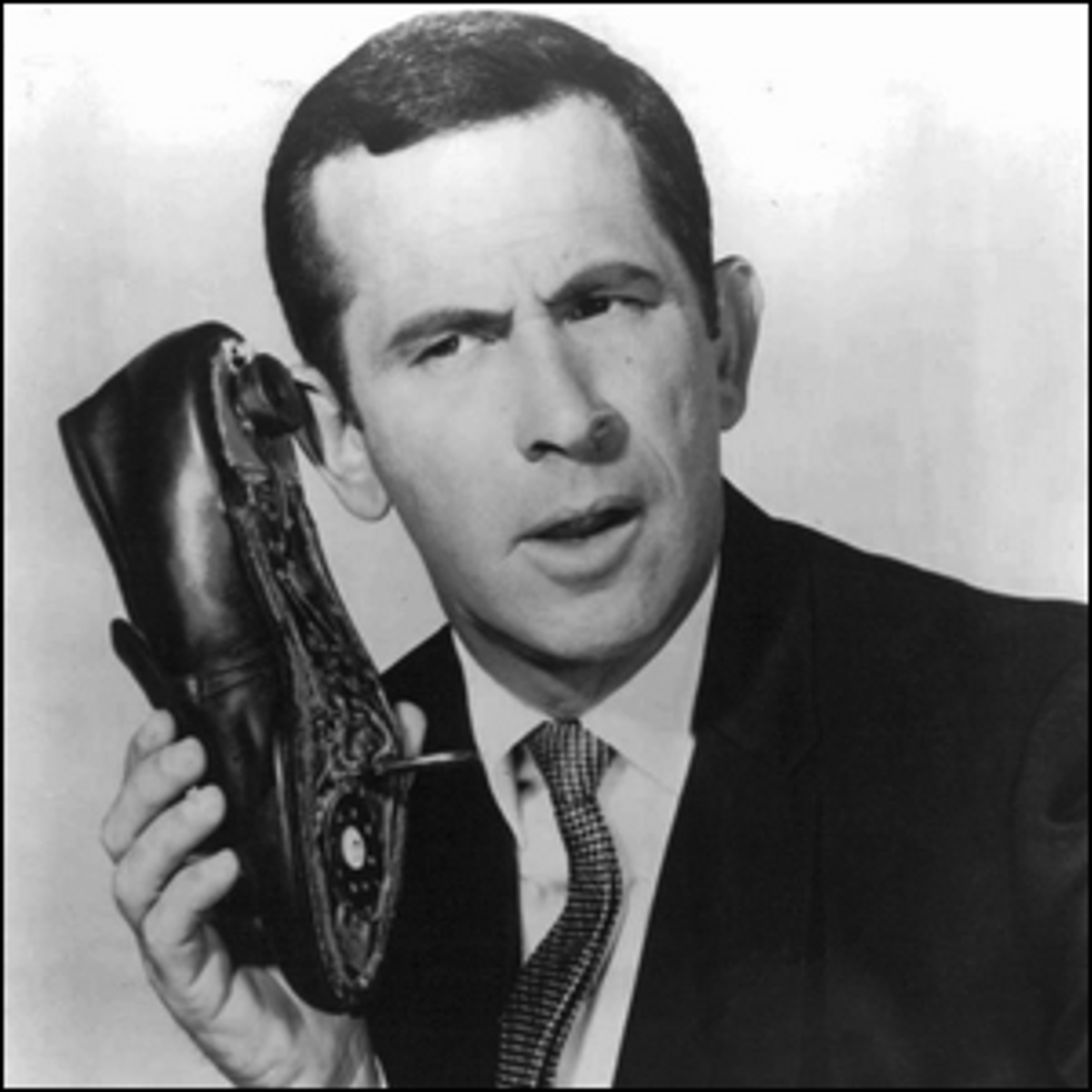 Don Adams as Maxwell Smart, with the infamous shoe phone.