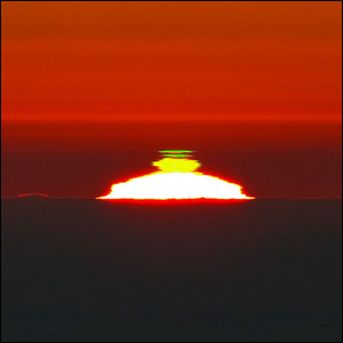 A double flash of green light as the Sun was setting on a sea of clouds below Cerro Paranal.