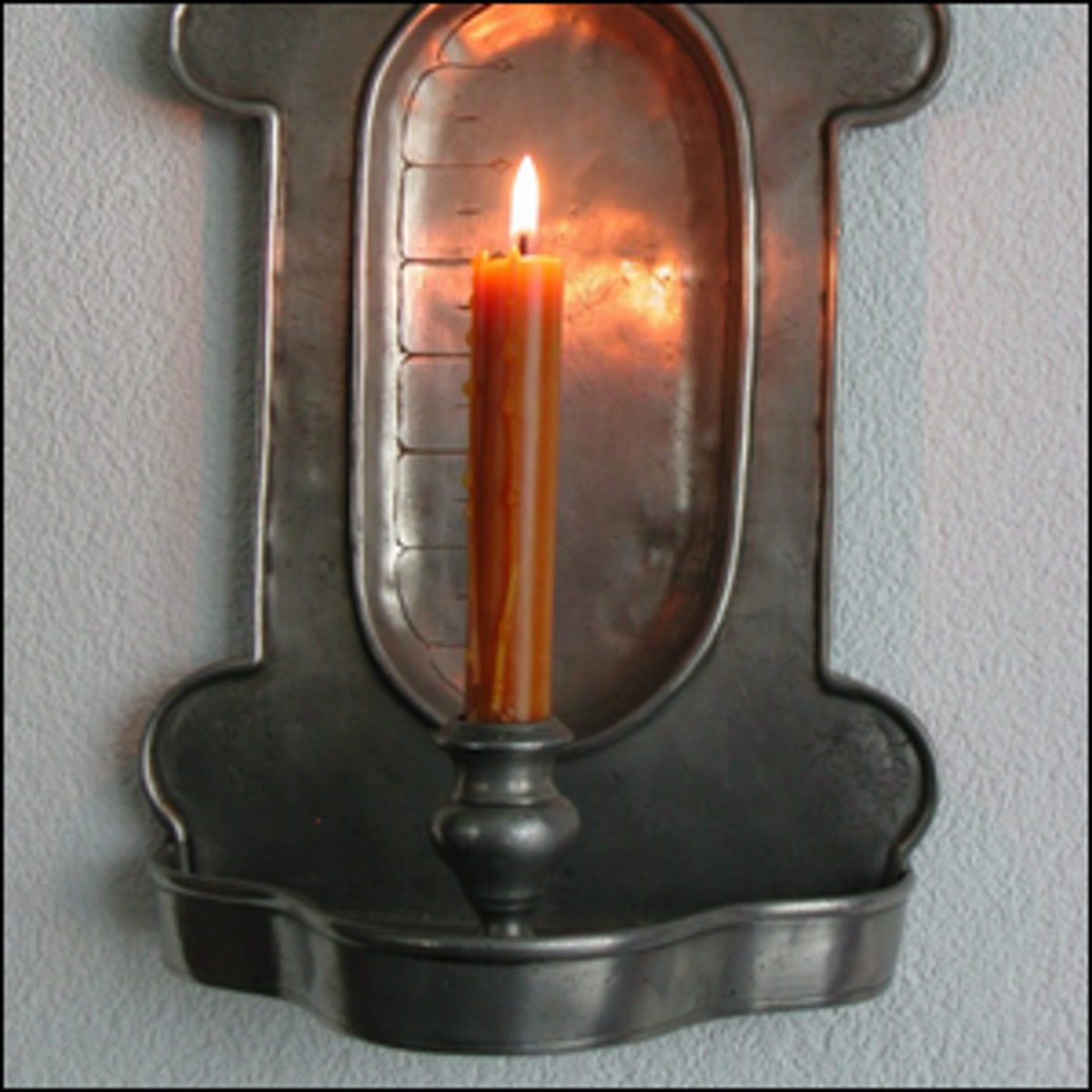 A candle clock being used.