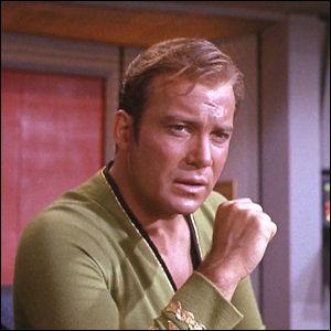 William Shatner, portraying Captain James T. Kirk recording a new log entry.