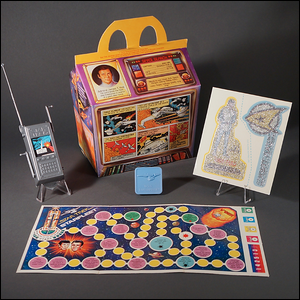 Various items included with the Happy Meals and one of the six Star Trek meal boxes.