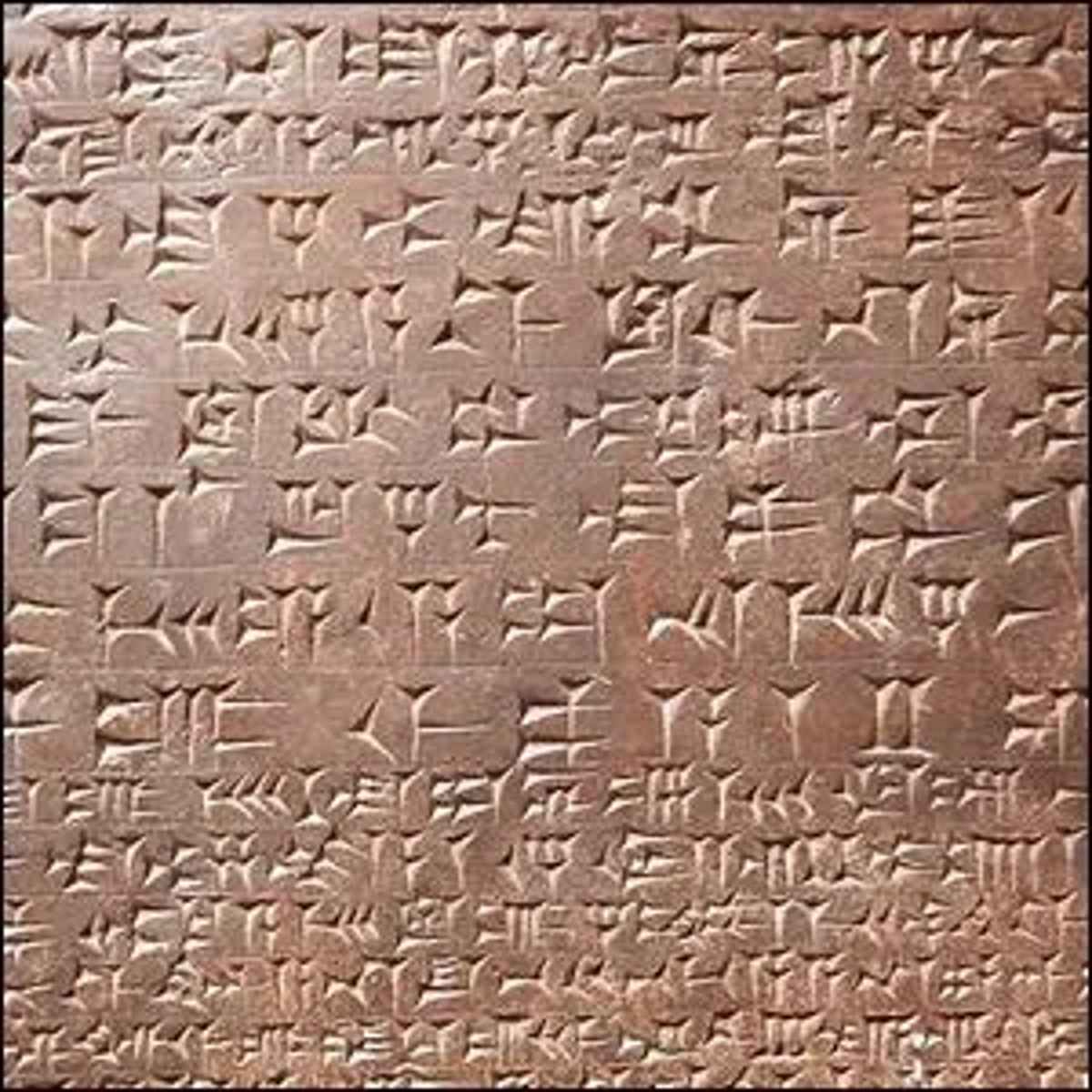 A fragment of a stone relief carved with the 'standard inscription' that records kings' names, titles, and ancestry in Assyrian.