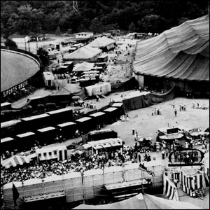 A photo of a 1950s era circus set up and operating at one of their stops.