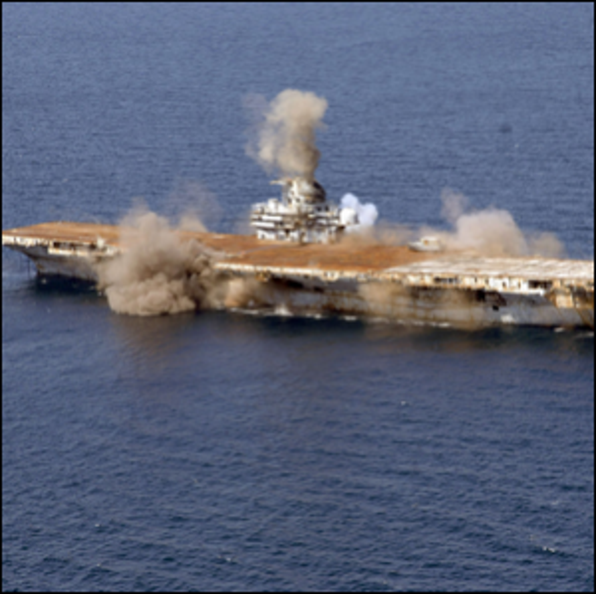 The beginning of the explosive charge detonations aboard the USS Oriskany.