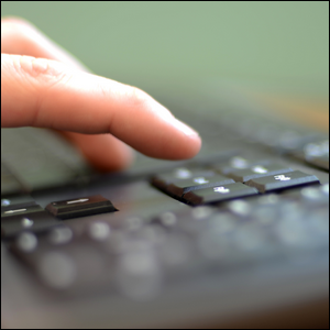 A person using their keyboard.