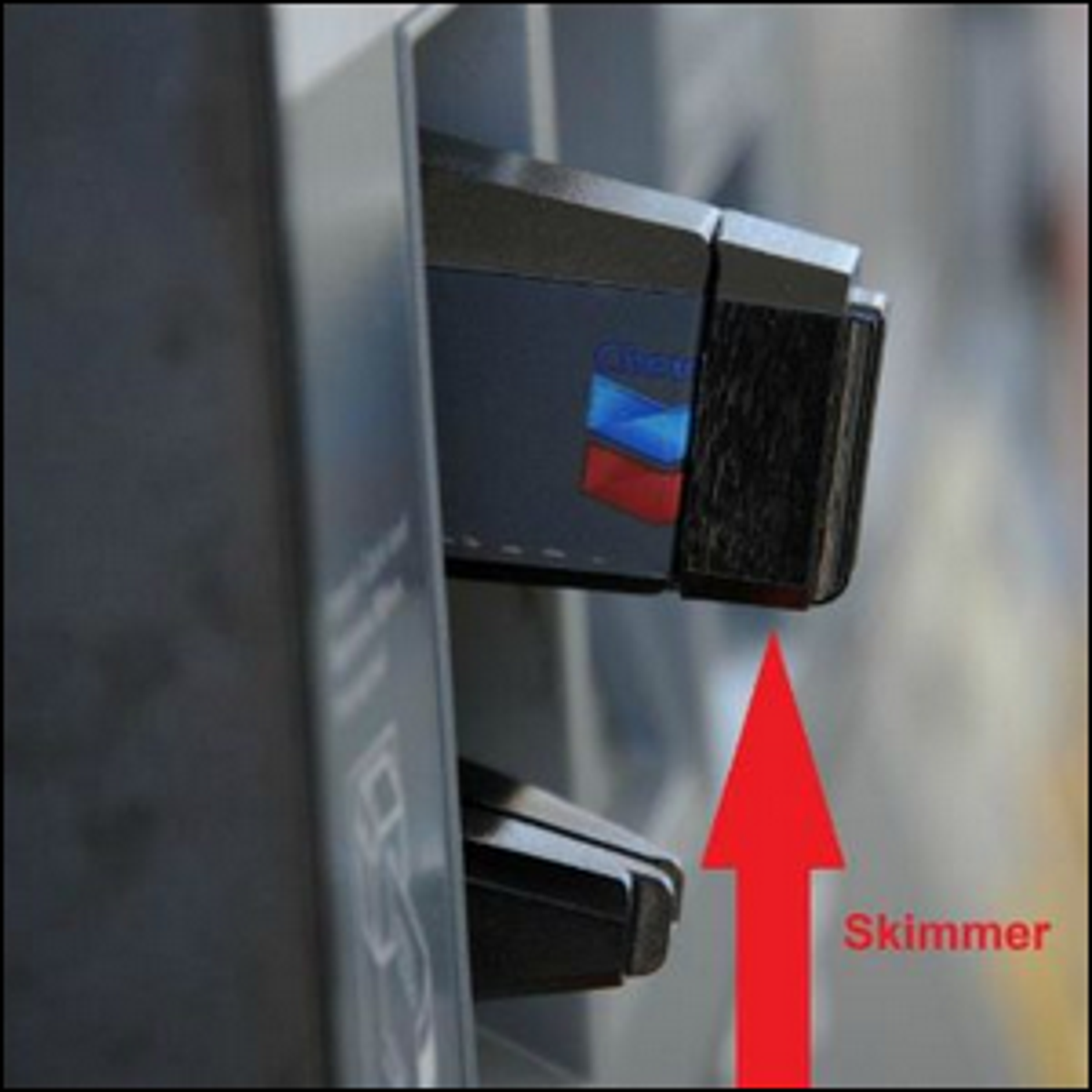 A credit card skimmer attached to a gasoline pump.