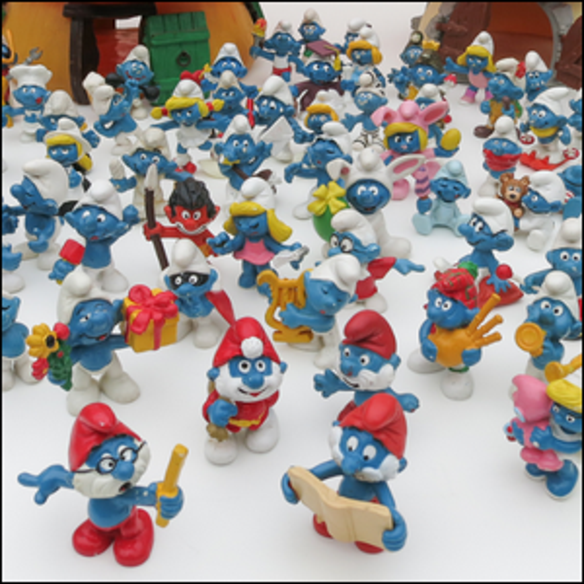 A group of Smurf figurines.