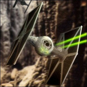 A Tie Fighter pursuing an enemy craft through a canyon.