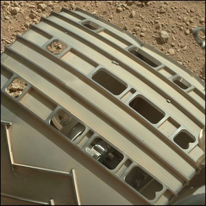 A close-up view of the Morse code tread on one of the Curiosity rover's wheels.