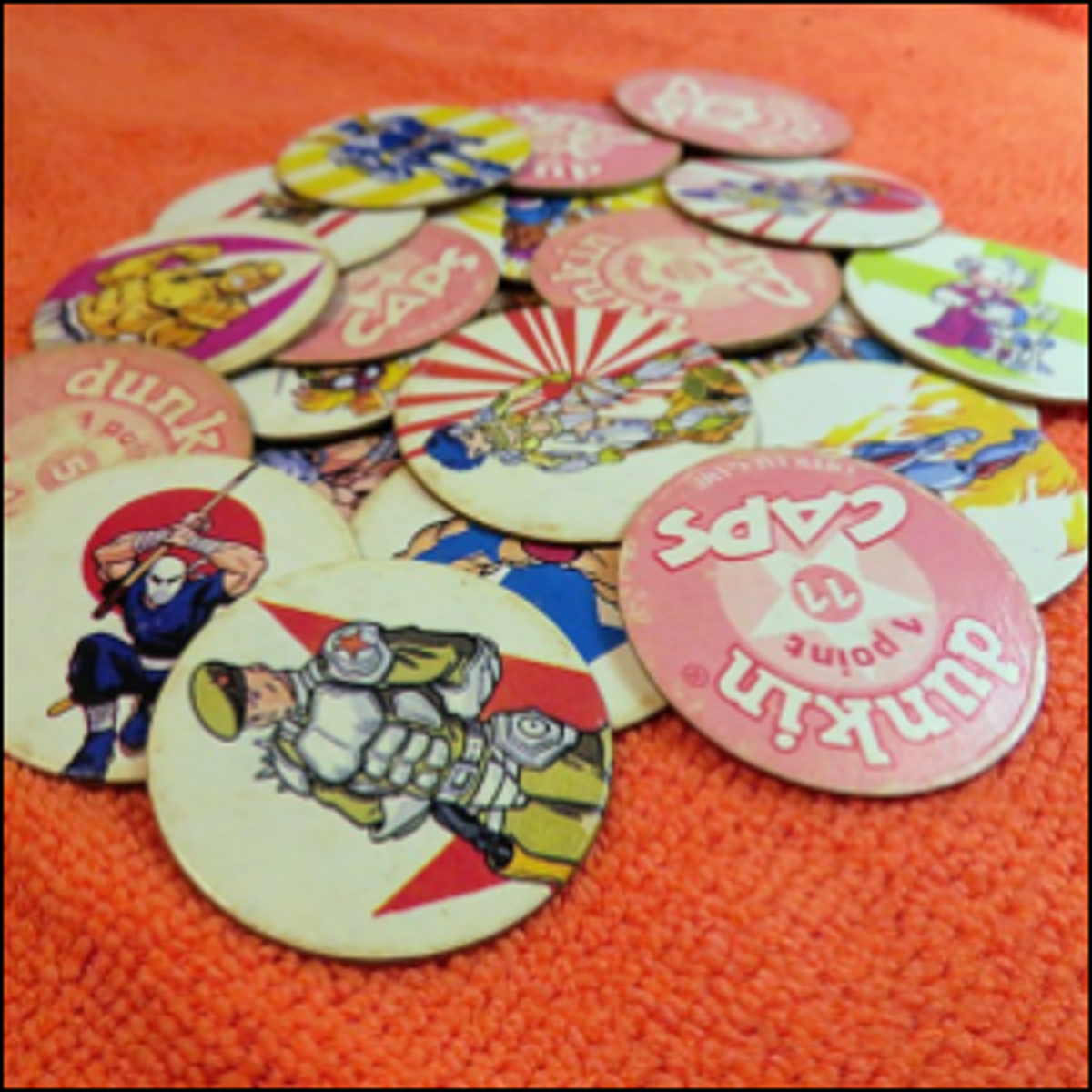 A handful of Pogs, spread out across a floor rug.