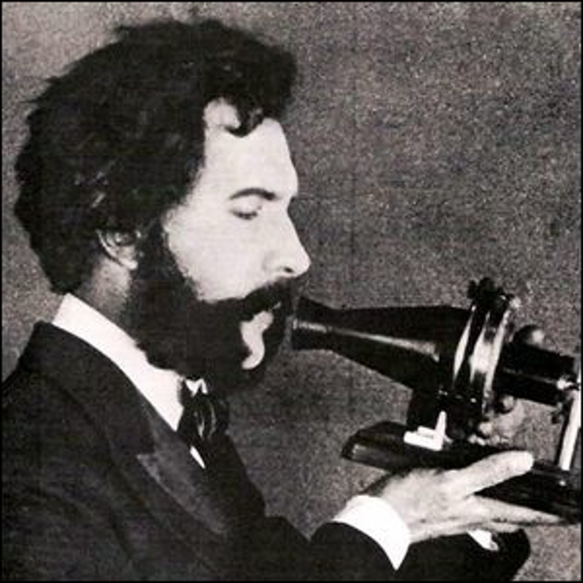 An actor portraying Alexander Graham Bell speaking into a telephone for a 1926 AT&T promotional film.
