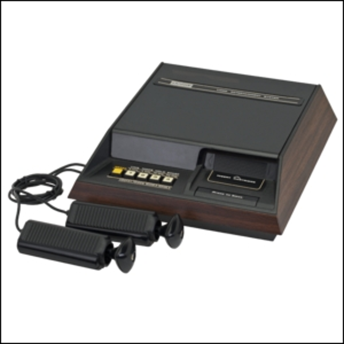 The Fairchild Channel F video game console with hard-wired controllers.