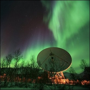 One of the EISCAT Radio Dishes seen against the Northern Lights.