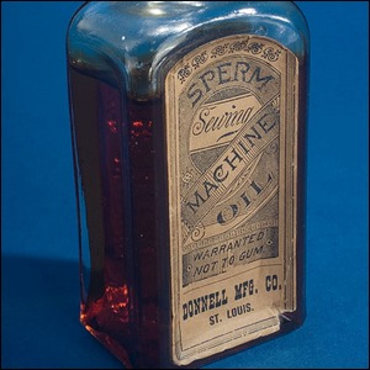 A 19th century bottle of sperm whale sewing machine oil.